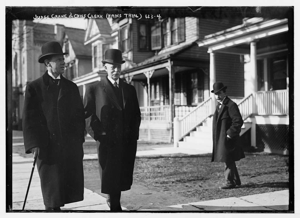 Judge Crane and Chief Clerk (Hains trial) on sidewalk, New York