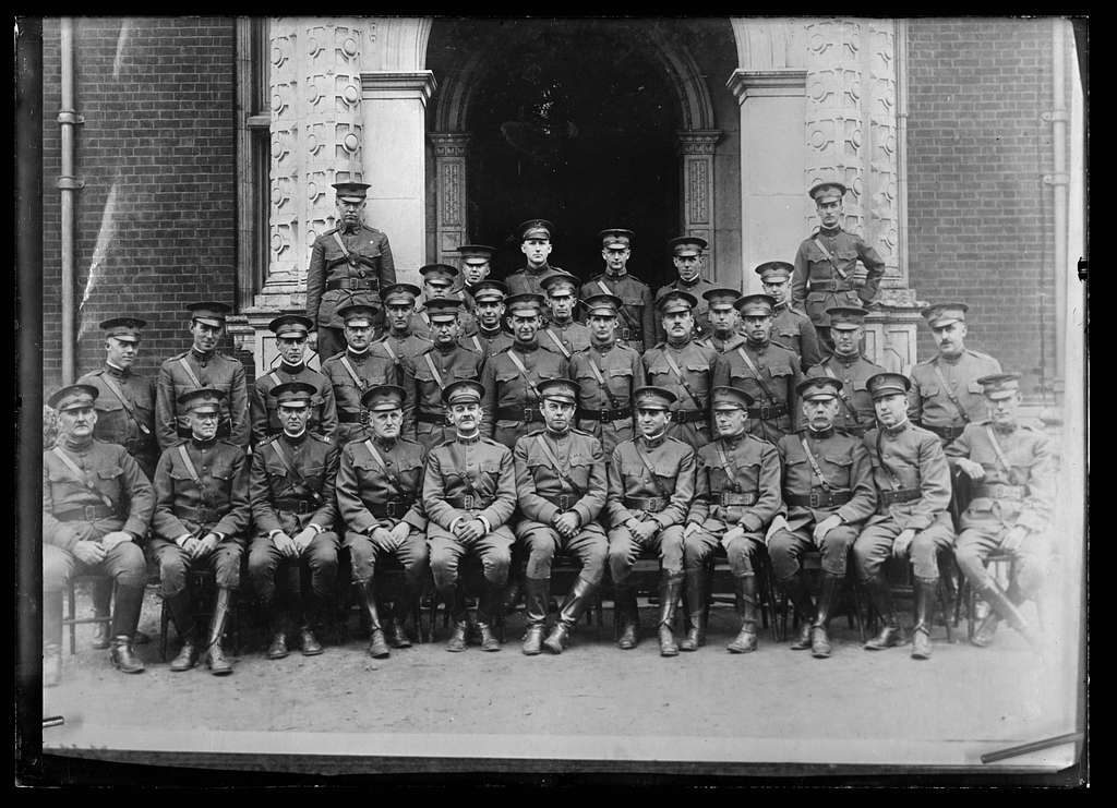 The Kentucky Unit. Medical Staff of the new American Red Cross hospital at Sarisbury, near Southampton. Grouped at the beautiful carved stone entrance to the main building of the hospital