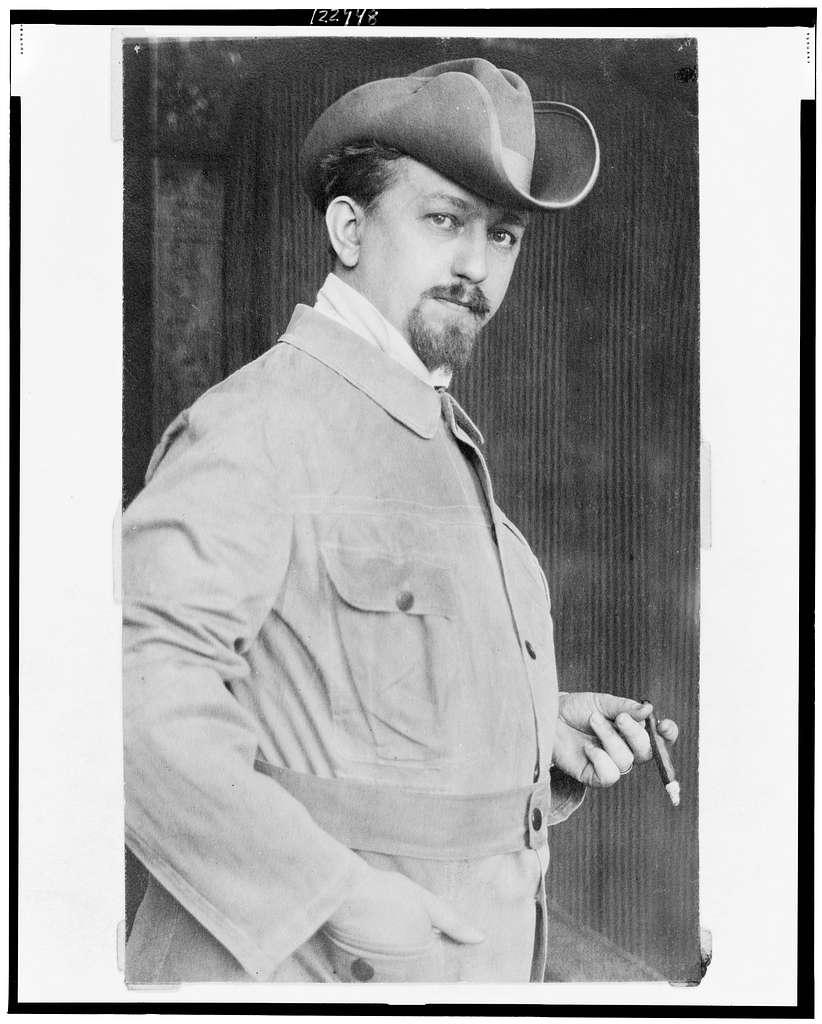 [Leo Frobenius, half-length portrait, standing, facing right, holding cigar]