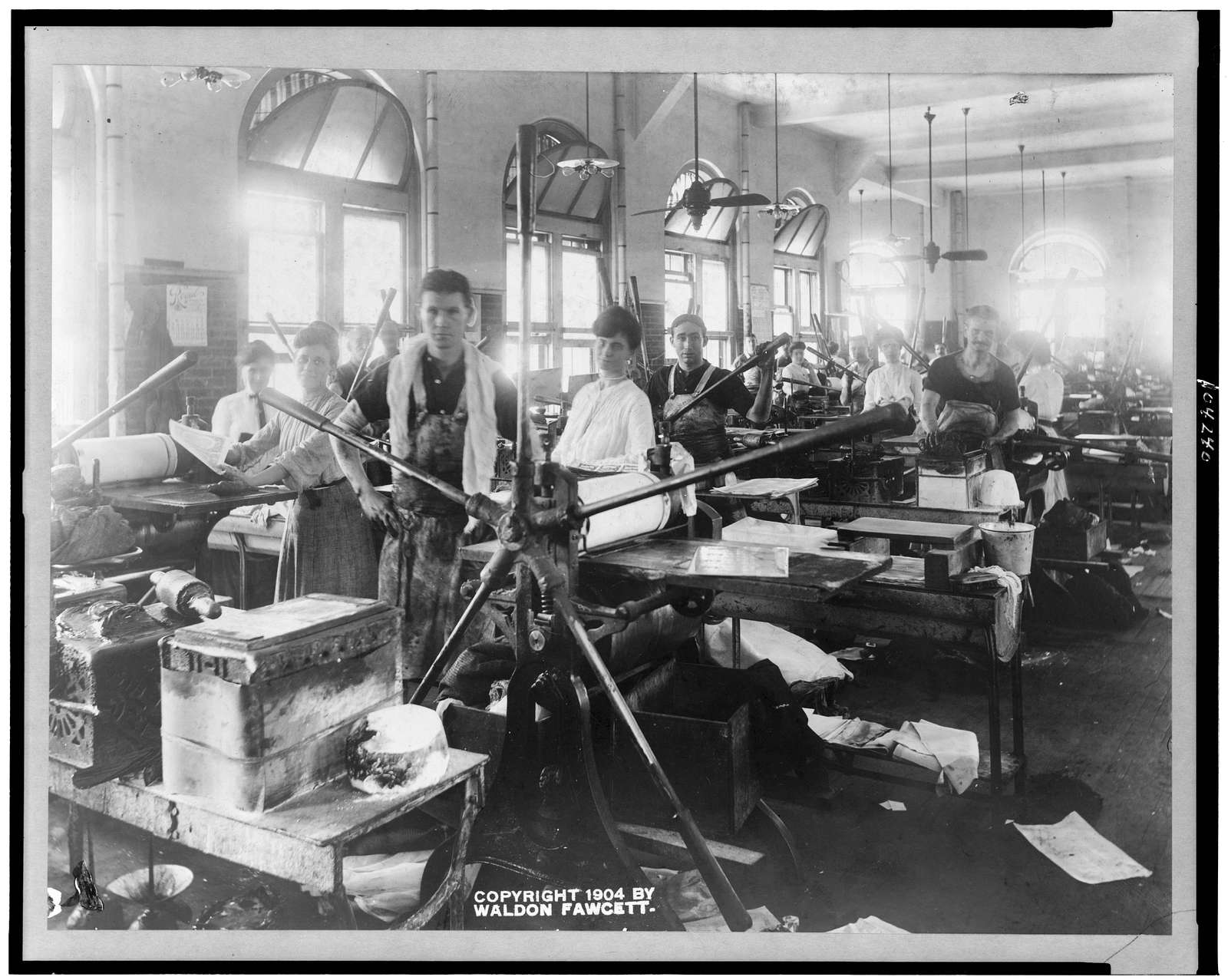 [Employees at printing presses in the Bureau of Engraving and Printing]