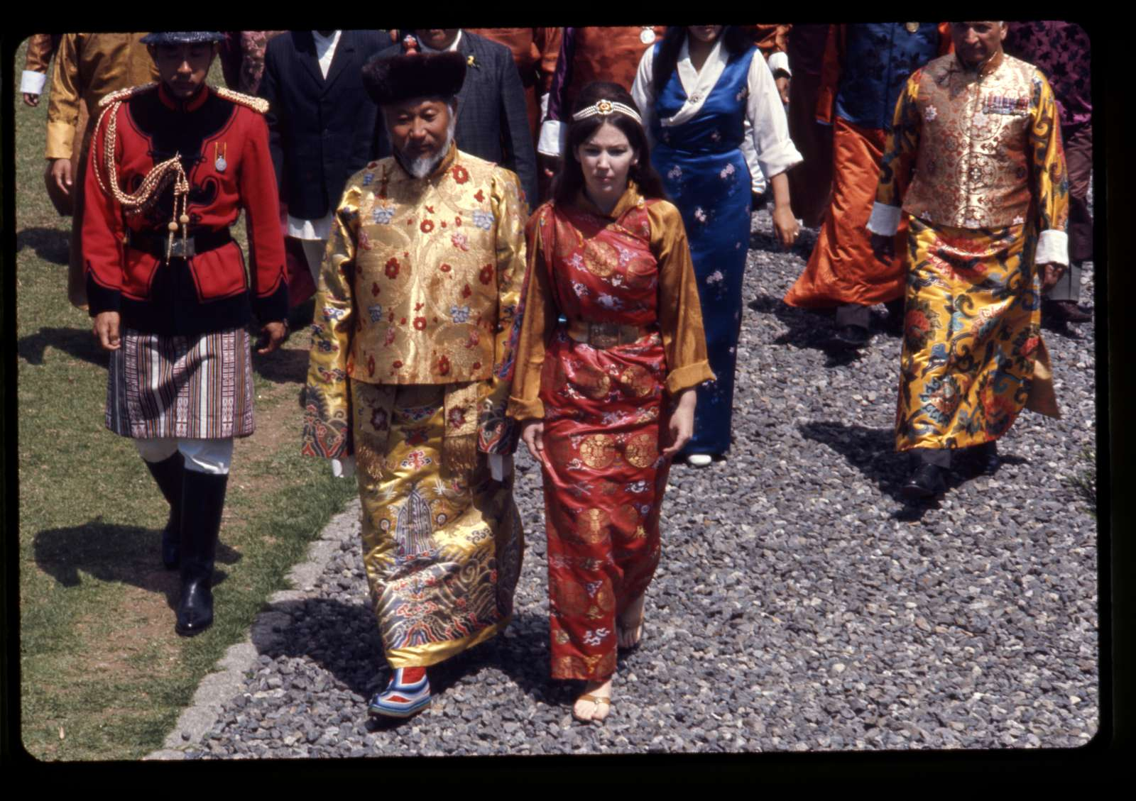 [Palden Thondup Namgyal, King of Sikkim, and Hope Cooke, Queen of Sikkim, in brocaded dress, walking to the Tsuklakhang Main Temple (Palace Temple) during the King's birthday celebration, Gangtok, Sikkim]