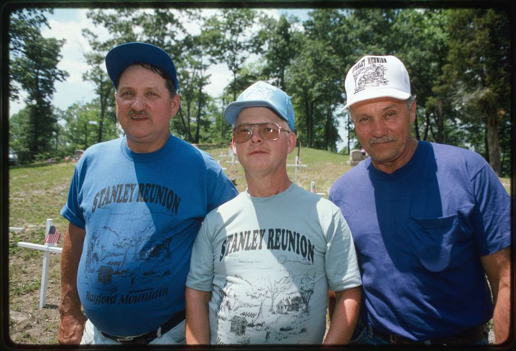Larry Gibson, center, with two unidentified friends, wearing Stanley Reunion t-shirts and hats