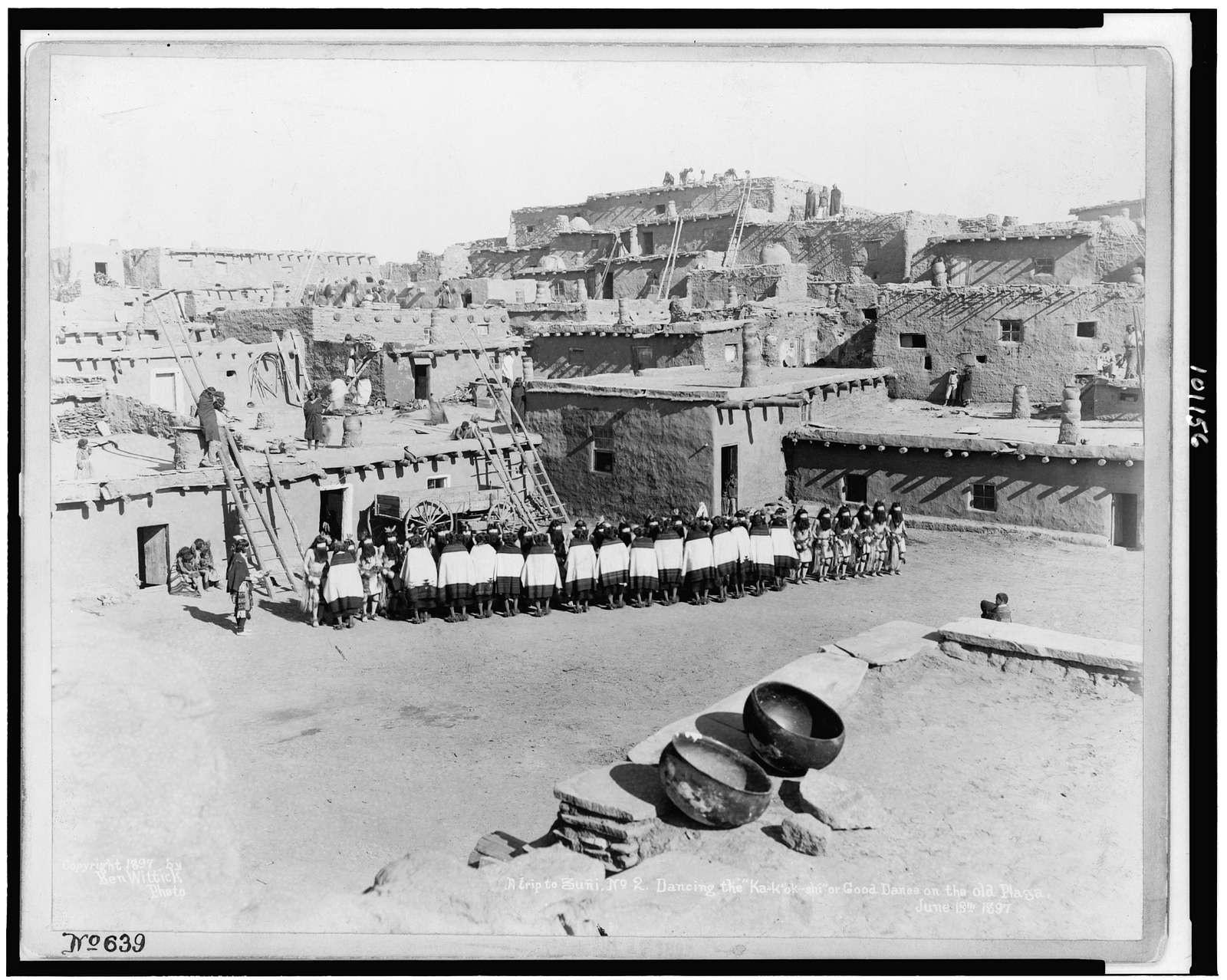 """A trip to Zuñi. No. 2. Dancing the """"ka-k'ok-shi,"""" or, Good dance on the old plaza. June 19th, 1897 / Ben Wittick photo."""