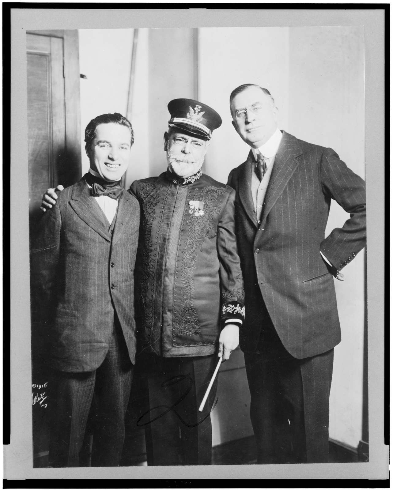 [John P. Sousa, Charlie Chaplin, and Clifford Harmon, full-length portrait, standing, facing front]