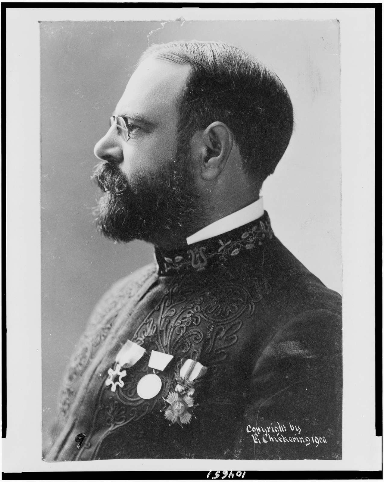 [John Philip Sousa, head-and-shoulders portrait, facing left, wearing band uniform with medals]