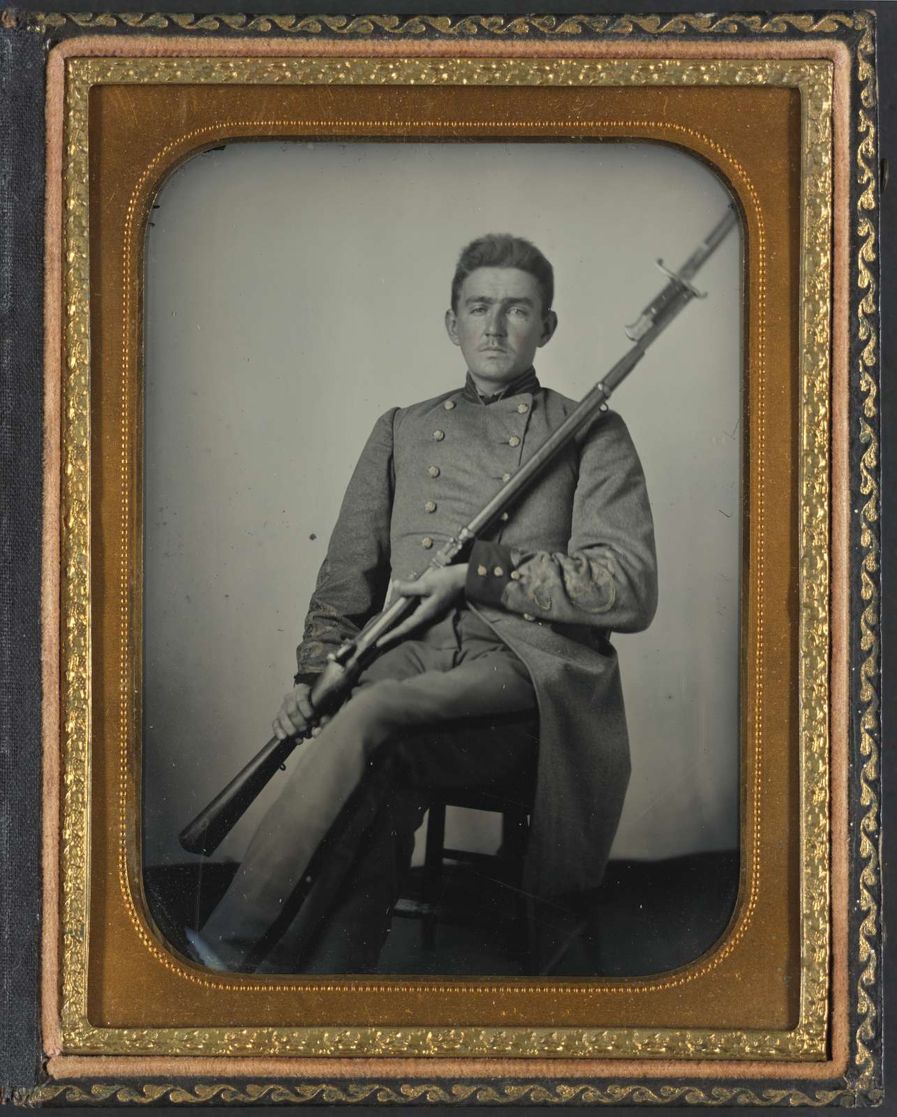 [Captain Daniel Turrentine of Company G, 12th Arkansas Infantry Regiment, in full officers' uniform with musket]